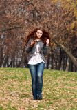 Autumn park. Beautiful young woman in autumn park Stock Images