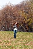 Autumn park. Beautiful young woman in autumn park Royalty Free Stock Photo