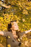 Autumn park and a beautiful brunette. Royalty Free Stock Photography