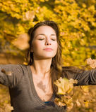 Autumn park and a beautiful brunette. Beautiful young brunette posing in the park at fall Royalty Free Stock Photos