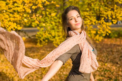 Autumn park and a beautiful brunette. Royalty Free Stock Photo