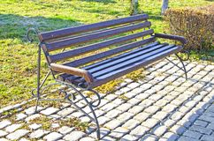 Autumn. Park bench covered with first snow royalty free stock image