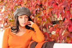 Autumn park bench young woman relaxing. Autumn leaves park scenery young woman relax sitting on bench royalty free stock photos