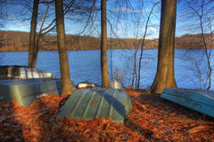 Autumn in the park. Boats on the ground around a lake Stock Image