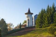 Autumn park castle. Like hotel among coniferous trees Stock Photo