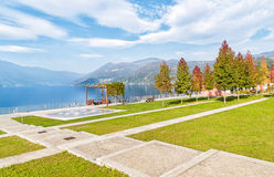 Autumn park with colorful trees. Autumn park with colorful trees on the lakefront of Luino, Varese, Italy royalty free stock photography