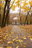 Autumn park with a footpath to summer house Royalty Free Stock Image