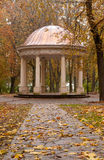 Autumn park with a footpath to summer house Stock Photo