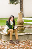 Autumn park fountain young woman hold phone Royalty Free Stock Photography