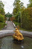 In the Autumn park. Golden statue in the fountain in the park of Linderhof Palace. Bavaria, Germany Stock Photos