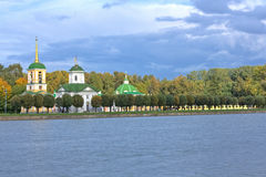 Autumn park Kuskovo. Church, Bell Tower and Grotto stock images