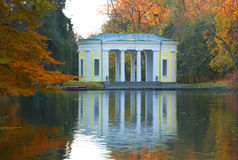 Autumn park lake scene. Ancient like pavilion in park lake scene in autumn Stock Photography