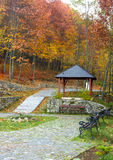 Autumn park landscape. Square to relax in the gazebo and benches Stock Photography