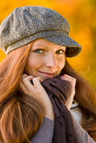 Autumn park - long red hair woman fashion Royalty Free Stock Image