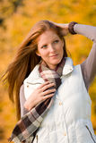 Autumn park - long red hair woman fashion Stock Photography