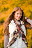 Autumn park - long red hair woman fashion Stock Image