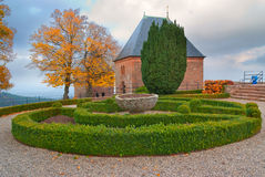 Autumn park in medieval castle Stock Image