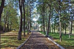 The autumn park near the monastery. Russia. Walk on the autumn park near the monastery. Russia Royalty Free Stock Image