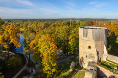 Autumn park with old castle ruins in Cesis town, Latvia Royalty Free Stock Image