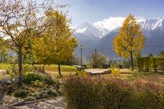 Autumn park overlooking the Austrian alps Royalty Free Stock Photos