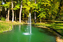 Autumn park, a pond and  small fountain Stock Photo