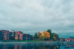 Autumn park in Tampere. Autumn scene near the Ratina area with residential buildings in Tampere, Finland Royalty Free Stock Images