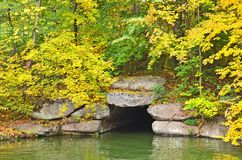Autumn park tree over grotto Royalty Free Stock Images