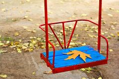 Autumn in park, yellow leaf on teeter Stock Image