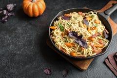 Spaghetti pasta with pumpkin and bacon Stock Photo
