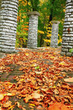 Autumn Path. Fall leaves strewn upon a brick walkway Stock Photo
