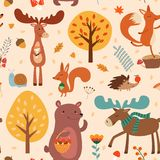 Autumn pattern with cute hand drawn forest animals and fall floral elements. Vector seamless texture. Autumn pattern with cute hand drawn forest animals and Royalty Free Illustration