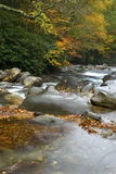 Autumn Peaceful Flowing Water. Peaceful flowing water in autumn in the Great Smoky Mountains in Tennessee, slow shutter speed used to make water silky smooth Royalty Free Stock Images