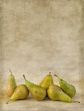 Autumn pears on grunge wallpaper Stock Photos