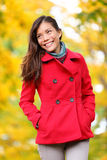 Autumn people - fall woman walking in forest. Colorful autumn concept portrait of young Asian woman enjoying fall foliage smiling happy outdoor in woods or Royalty Free Stock Photo