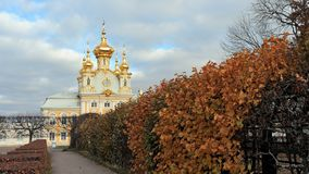 Autumn in Peterhof, church building of the large Peterhof Palace. In the background Royalty Free Stock Image