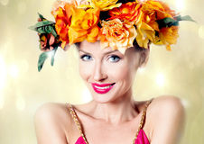 Autumn photo of young woman. Beauty portrait of smiling young attractive woman with autumn flowers on head. Conceptual photo stock image