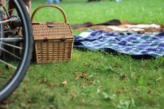 Autumn picnic. Outdoors with blankets and wicker basket Royalty Free Stock Photos