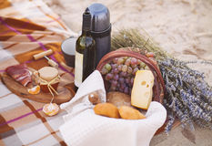 Autumn picnic by the sea with wine, grapes, bread and cheese Royalty Free Stock Images