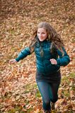 Autumn pleasure - young woman runing Stock Images