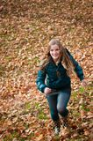Autumn pleasure - young woman runing Royalty Free Stock Photography