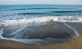 Autumn in Pomorie, waves on a deserted beach, Bulgaria Royalty Free Stock Image