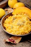 Autumn porridge with pumpkin. Homemade tasty porridge with orange pumpkin on rustic background.Healthy vegetarian meal stock photography