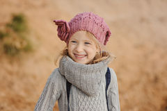 Autumn portait of happy child girl in knitted hat Royalty Free Stock Images