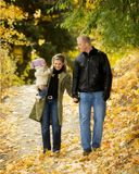 Autumn portrait. Young family outdoor portrait in autumn foliage Stock Image