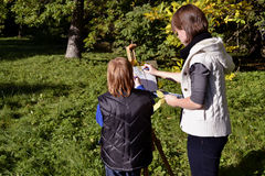 Autumn portrait. Female painter and boy painting in a city park Stock Photography
