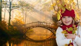 Autumn portrait. Lovely girl in autumn park Royalty Free Stock Photo