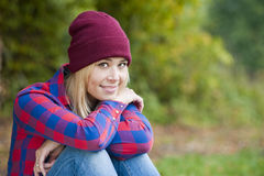 Autumn portrait. Portrait of a young woman in an autumn landscape royalty free stock photos