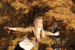 Autumn Portrait. Portrait of a young girl flying royalty free stock photos