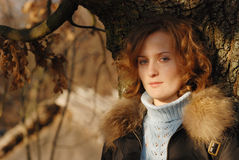 Autumn portrait. Portrait of young girl near oak Stock Photos
