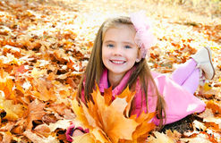 Autumn portrait of adorable little girl with maple leaves Stock Images